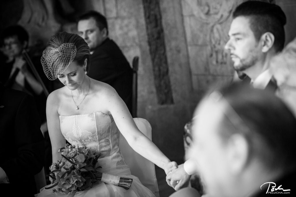 bride and groom sittinh and holding theirt hands