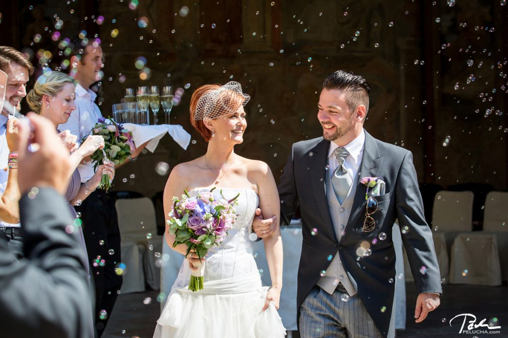 guests throwing petals on newlyweds in the receiving line