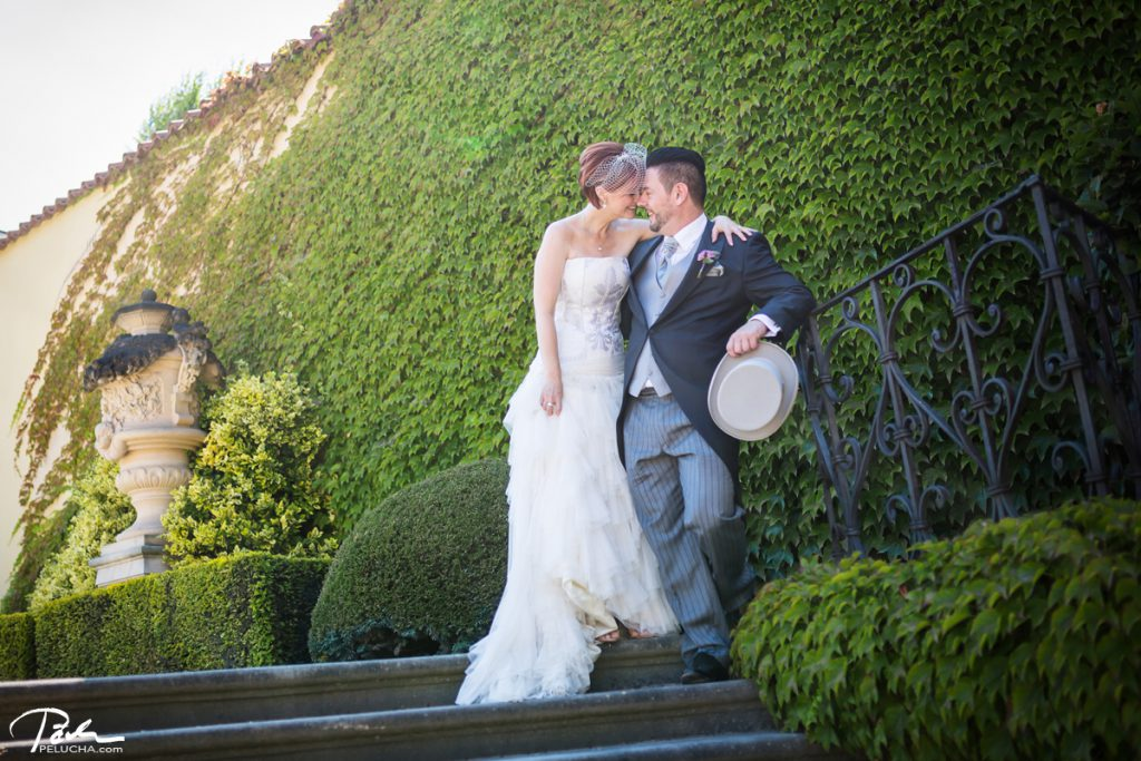 bride and groom in the garden hugging each other