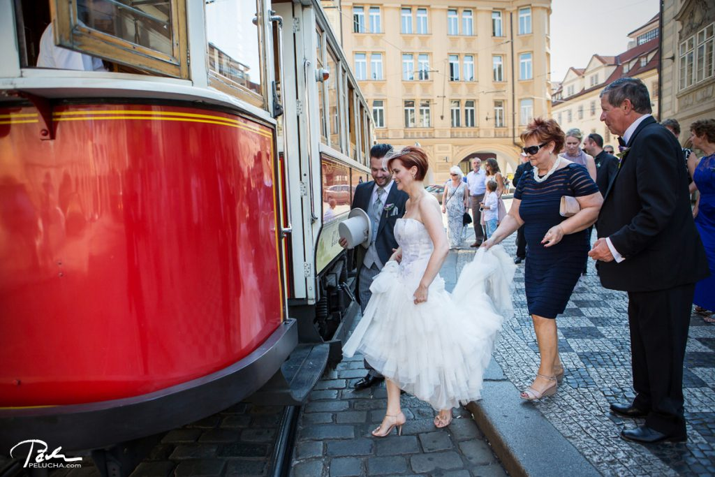 bride's mother holding the veil as they enter the historical tram