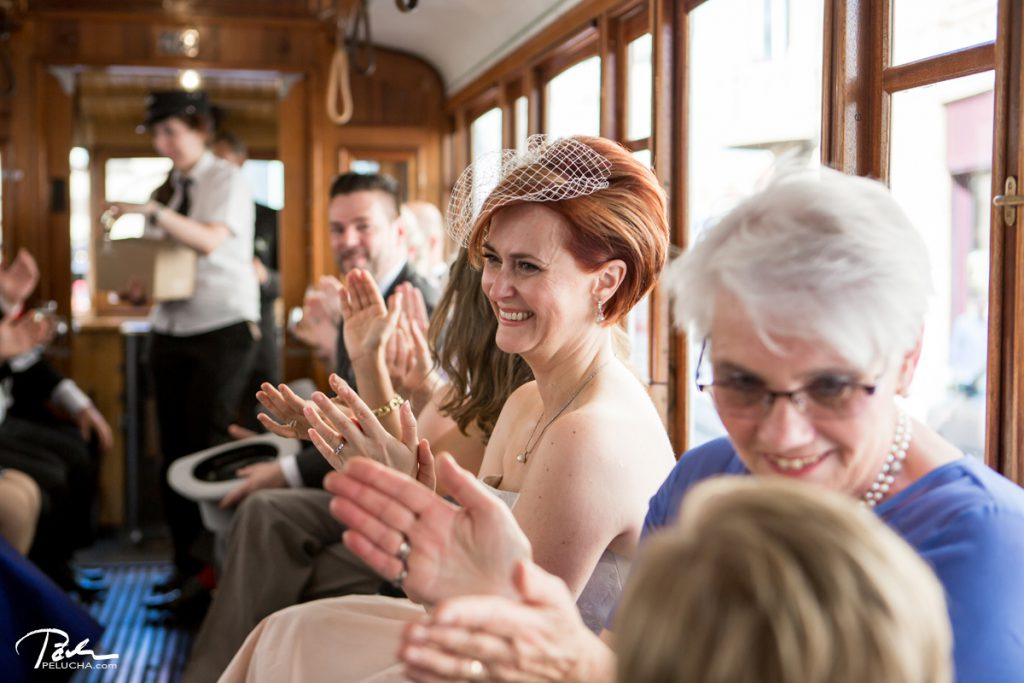 bride and guests having fun in the tram