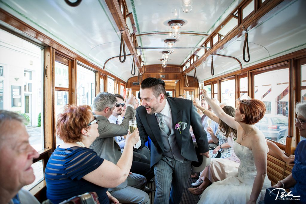 groom toasting with all the guests in the tram