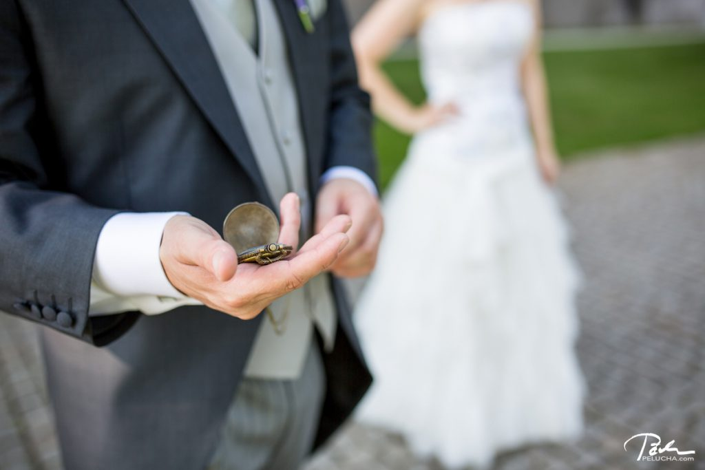 groom holding his old style watch and checking the time