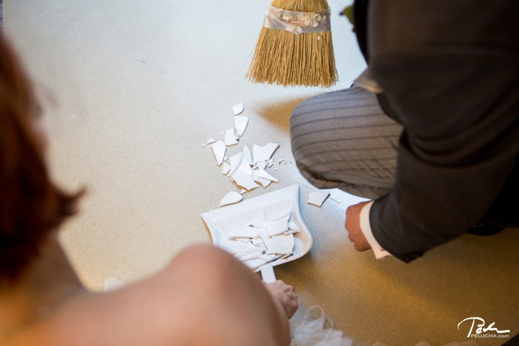 newlyweds sweeping the broken plate, czech tradition