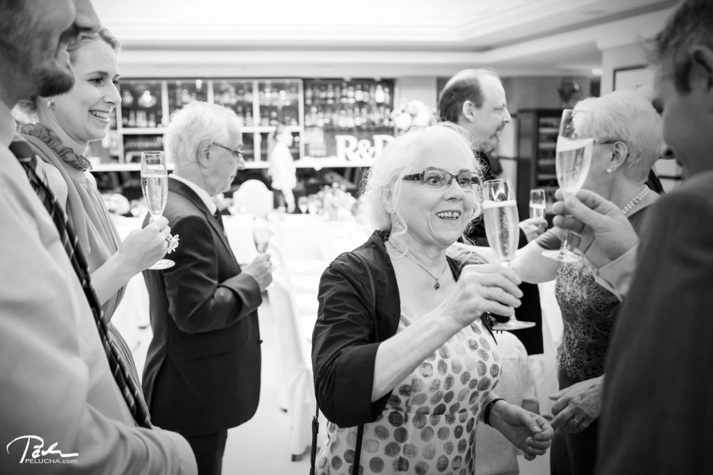 guests toasting with the champagne in the hotel