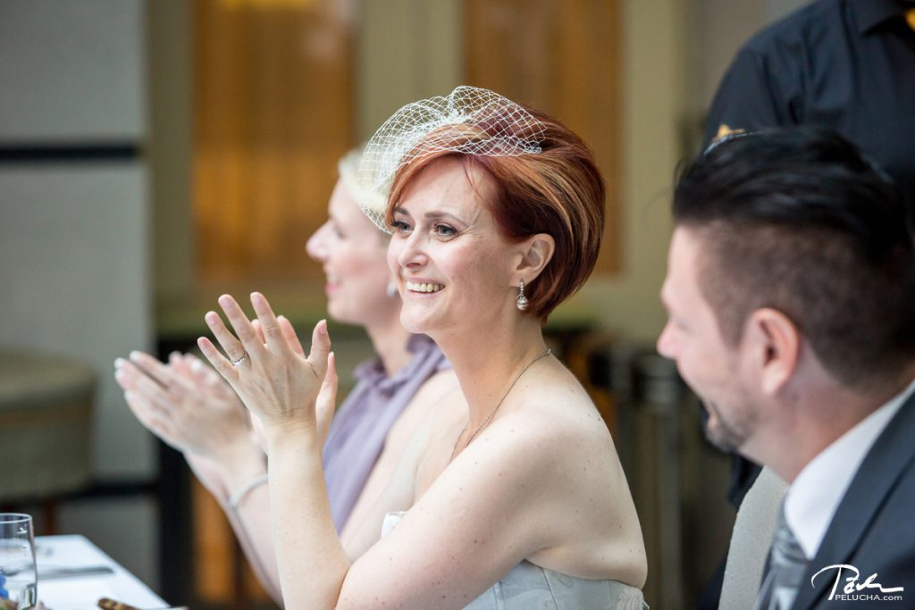 bride clapping after the speech
