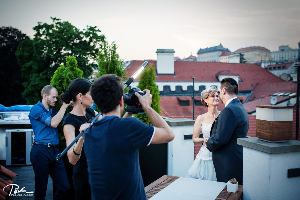 videographers and assistant filming the couple